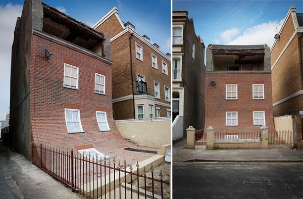 O fatada din caramida se topeste de pe un bloc de apartamente